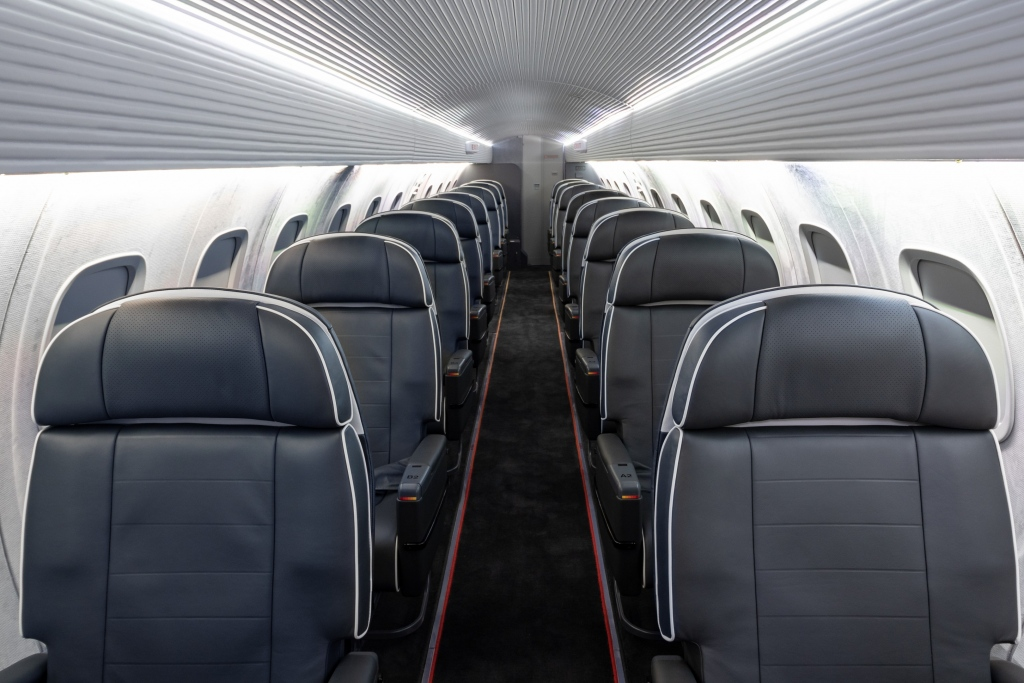 Interior regional aircraft conversion on Embraer aircraft - photo of aircraft aisle with one seat on either side
