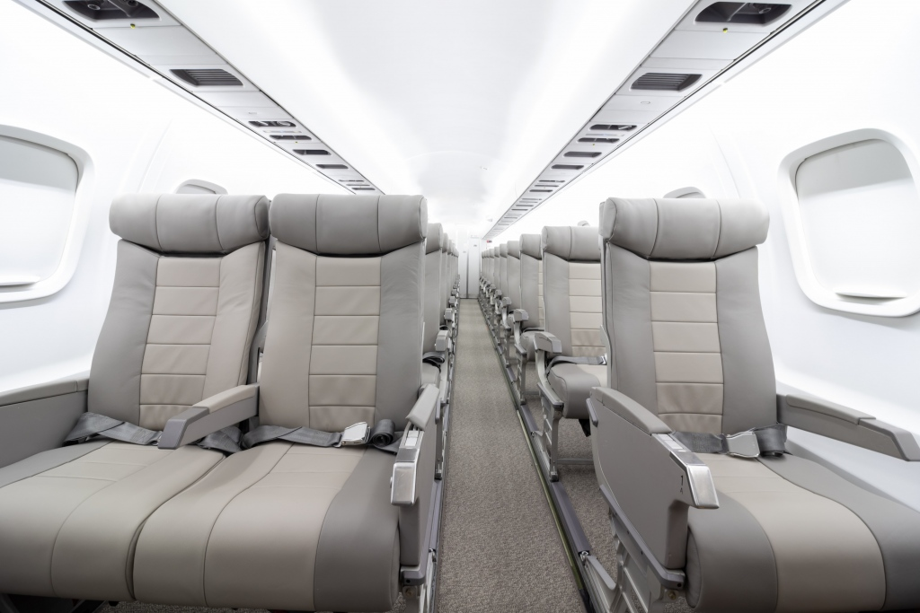 Interior regional aircraft conversion on Embraer aircraft - photo of aircraft aisle with one seat on the right and two seats on the left