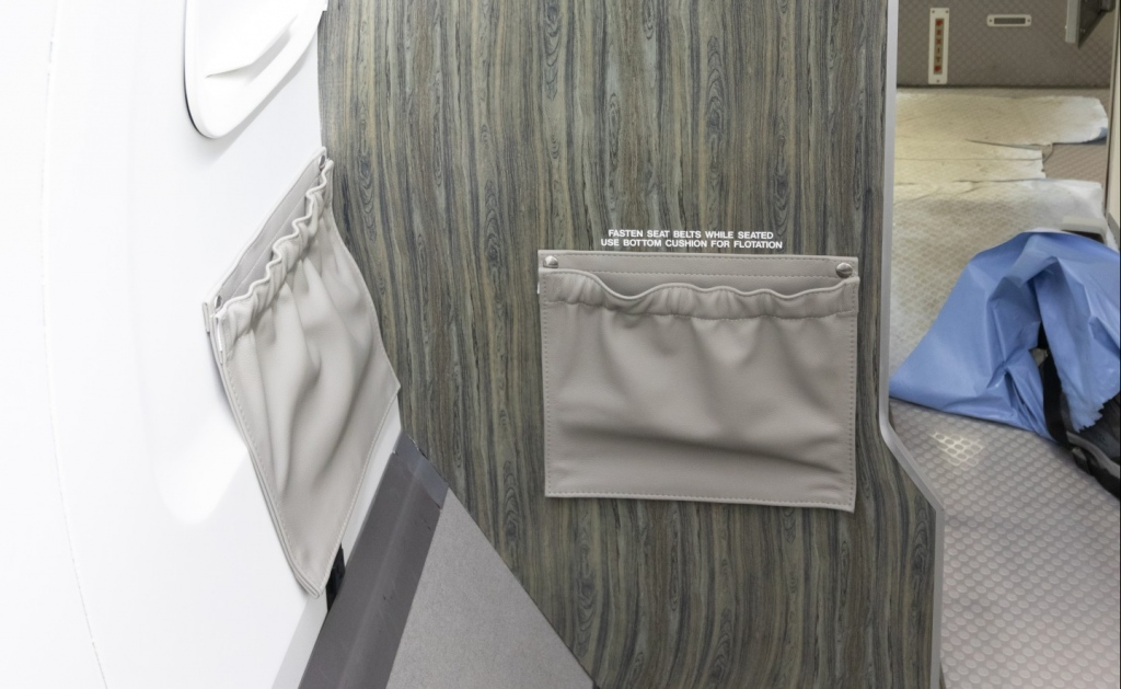 Interior regional aircraft conversion on Embraer aircraft - photo of aircraft cabinetry with two pockets