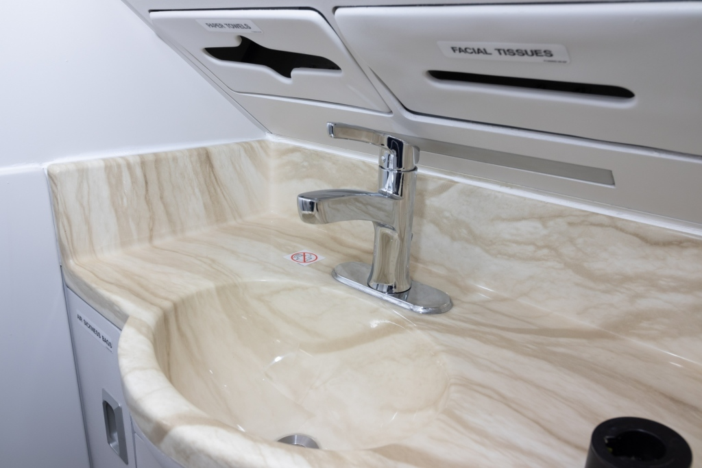 Interior regional aircraft conversion on Embraer aircraft - photo of aircraft laboratory sink and cabinets