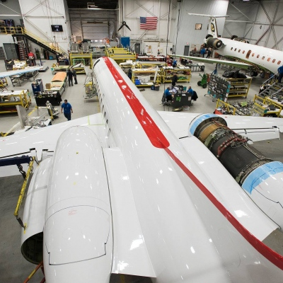 Interior regional aircraft conversion on Embraer aircraft - photo of three aircraft being worked on in a hangar