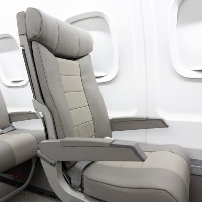Interior regional aircraft conversion on Embraer aircraft - photo of gray aircraft seat