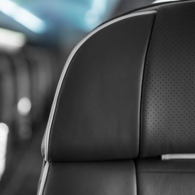 Interior regional aircraft conversion on Embraer aircraft - upclose photo of black aircraft seat upholstry