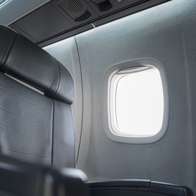 Interior regional aircraft conversion on Embraer aircraft - photo of aircraft seat and open window shade